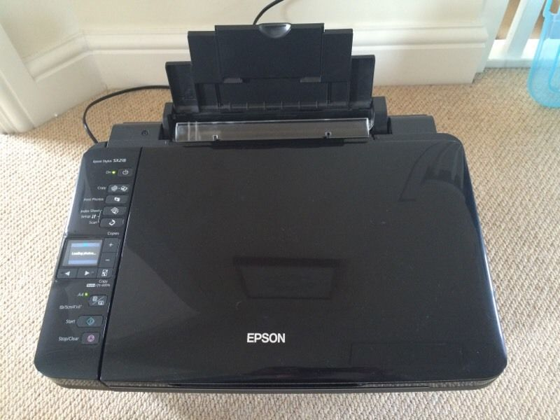 Epson Stylus SX218 printer with spare cartridges in 