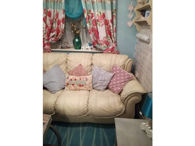 Beautiful cream Italian leather sofa £40 Also floral shabby chic curtains and large turquoi