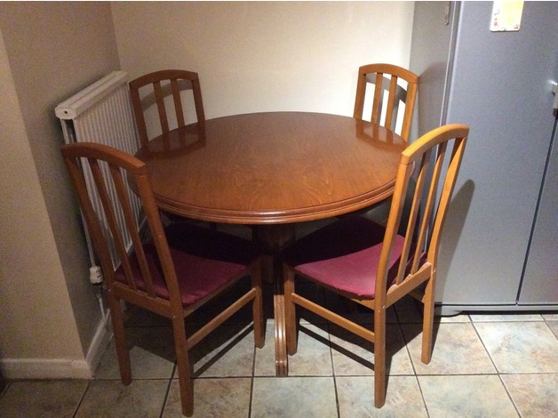 Round Dining table and four chairs in Swansea